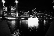 Toronto City Hall Building And Reflecting Pool In Nathan Phillips Square At Night Print by Joe Fox
