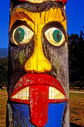 Faces Photos - Totem pole with tongue sticking out by Garry Gay