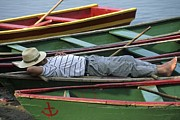 Guides Metal Prints - Tour Boat Guide Naps Amidst Rowboats Metal Print by Raymond Gehman