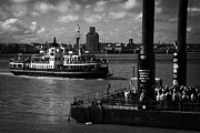 Liverpool Prints - Tourists And Commuters Queue Up At The Pier Head Floating Ferry Terminal For The Mersey Ferry Print by Joe Fox