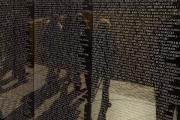Vietnam Veterans Memorial Posters - Tourists Walking By Reflected Poster by Todd Gipstein