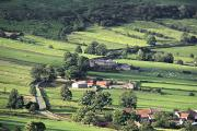 Arial View Photos - Town On Hillside, North Yorkshire by John Short