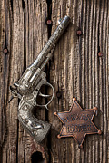 Badge Framed Prints - Toy gun and ranger badge Framed Print by Garry Gay