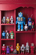 Shelves Photo Prints - Toy robots on shelf  Print by Garry Gay