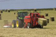 Tractor Photo Posters - Tractor bailing hay at harvest time Poster by Andy Smy