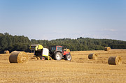 Machinery Photo Posters - Tractor Harvesting Hay Poster by Jaak Nilson