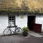 Thatch Posters - Traditional Thatch roof cottage Ireland Poster by Pierre Leclerc
