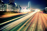 Los Angeles Skyline Framed Prints - Traffic Trail Lights In Downtown At Night Framed Print by Garrett Meyers