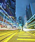 Light Trail Prints - Traffic Trails In City Print by Leung Cho Pan