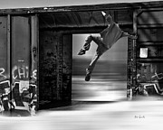 Bizarre Photo Prints - Train Jumping Print by Bob Orsillo