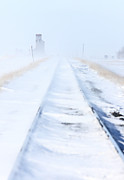 Excess Prints - Train Tracks and Grain Elevator in Blizzard Saskatchewan  Print by Mark Duffy