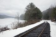 Train Tracks In Snowy Landscape Print by Roberto Westbrook