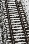 Ballast Framed Prints - Train Tracks Lightly Covered With Snow Framed Print by Keith Levit