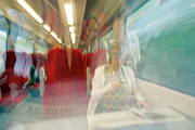 Texting Photo Prints - Train Travel Print by Carlos Dominguez