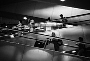 Bangkok Photos - Traveler walking on escalator at Suvarnabhumi Airport by Setsiri Silapasuwanchai