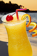 Alcoholic Photos - Tropical orange drink by Elena Elisseeva