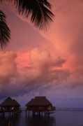 Bungalows Prints - Tropical Skies and Bungalows Print by Owen Ashurst