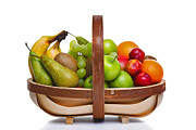 Kiwi Posters - Trug full of fresh fruit isolated on white background. Poster by Richard Thomas