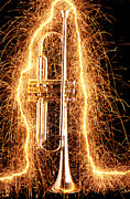 Music Photo Posters - Trumpet outlined with sparks Poster by Garry Gay