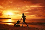 Pastime Posters - Tumon Bay, Man with baby stroller Poster by Greg Vaughn - Printscapes