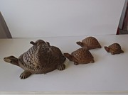 Friendly Sculptures - Turtles on a stroll by Warli Artists