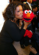 Talk Show Host Posters - Tv Host Oprah Winfrey And Friend Elmo Poster by Everett