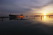 Maine Scenes Prints - Twilight View Of A Ship At Anchor Print by Bill Curtsinger