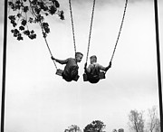 Two By Two Framed Prints - Two Boys (6-8) On Swings, Rear View (b&w) Framed Print by Hulton Archive