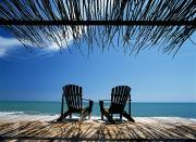 Jamaican Photos - Two Chairs On Deck By Ocean Shaded By by Axiom Photographic