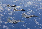Jet Fighter Photo Posters - Two F-15 Eagles And F-22 Raptors Fly Poster by HIGH-G Productions