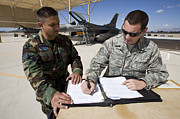 Paperwork Prints - Two F-16 Crew Chiefs Go Over Paperwork Print by HIGH-G Productions