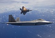 Jet Fighter Photo Posters - Two F-22 Raptors Release Flares While Poster by HIGH-G Productions