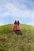 Pink Dresses Prints - Two Girls in Vintage Dresses Walking up Grassy Hill Print by Jill Battaglia
