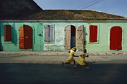 Haitian Photos - Two Girls Run From The Photographer by James P. Blair