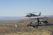 Fueling Posters - Two Hh-60 Pave Hawks Refuel Poster by Stocktrek Images