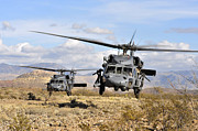 Helicopter Pilot Framed Prints - Two Hh-60 Pavehawk Helicopters Framed Print by Stocktrek Images