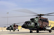 Static Prints - Two Iraqi Mi-17 Hip Helicopters Conduct Print by Stocktrek Images