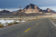 Bleak Desert Framed Prints - Two Lane Highway Passing Through the Desert Framed Print by Thom Gourley/Flatbread Images, LLC