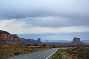 Scrub Brush Prints - Two Lane Road Passing Through Desert Print by Ned Frisk