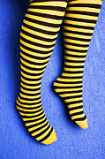 Foot Posters - Two legs against blue wall Poster by Garry Gay