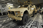 Up-armored Framed Prints - Two M-atvs Await Transport On A C-17 Framed Print by Stocktrek Images