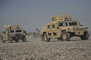 M1114 Photos - Two M1114 Humvee Vehicles At Camp Taji by Stocktrek Images