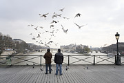 Feeding Birds Prints - Two People Feeding Pigeons On Pont Des Arts Bridge, Rear View Print by Ed Freeman