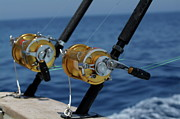 Fishing Rods Prints - Two rod and reels on board a game fishing boat in the Mediterranean Sea Print by Sami Sarkis