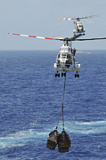 At Sea Framed Prints - Two Sa-330 Puma Helicopters Deliver Framed Print by Stocktrek Images