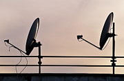 Communication Photos - Two Satellite dishes and sunset sky by Sami Sarkis