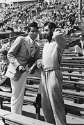 Mid Summer Framed Prints - Two Spectators At International Sporting Event Framed Print by Charles H. Hewitt/Haywood Magee