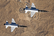 Aviator Posters - Two T-38a Mission Support Aircraft Fly Poster by Stocktrek Images