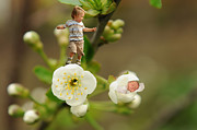 Bud Digital Art Prints - Two tiny kids playing on flowers Print by Jaroslaw Grudzinski
