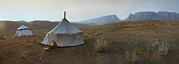 Animal Place Posters - Two Traditional Yurts On A Flat Plain Poster by Phil Borges